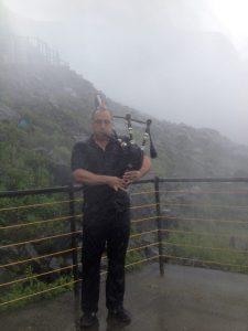 Playing bagpipes under Niagara Falls New York 2014